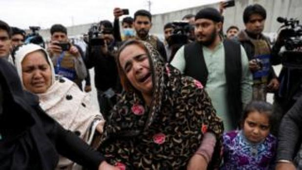 Security: An Afghan Sikh woman grieves for her relatives near the site of an attack in Kabul, Afghanistan March 25, 2020
