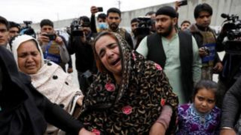 An Afghan Sikh woman grieves for her relatives near the site of an attack in Kabul, Afghanistan March 25, 2020