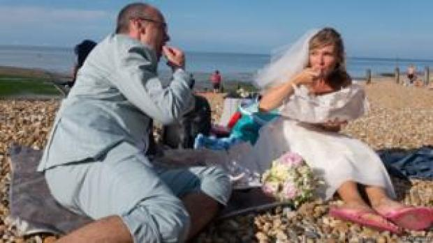 Newlyweds pictured on a beach