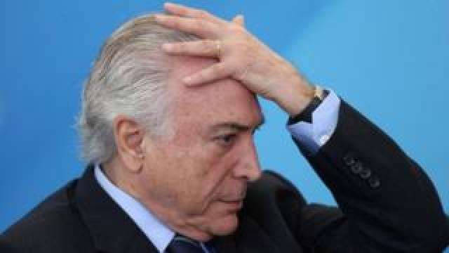 Brazil's President Michel Temer reacts during a ceremony at the Planalto Palace in Brasilia (13 July 2017)