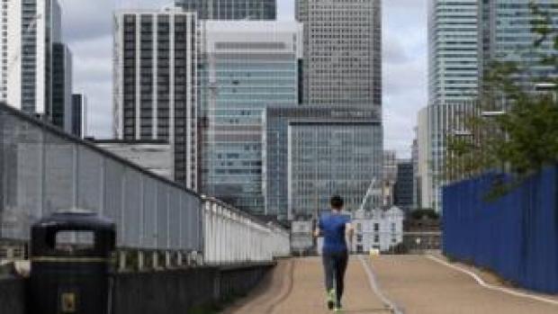 A jogger runs through a quiet Canary Wharf
