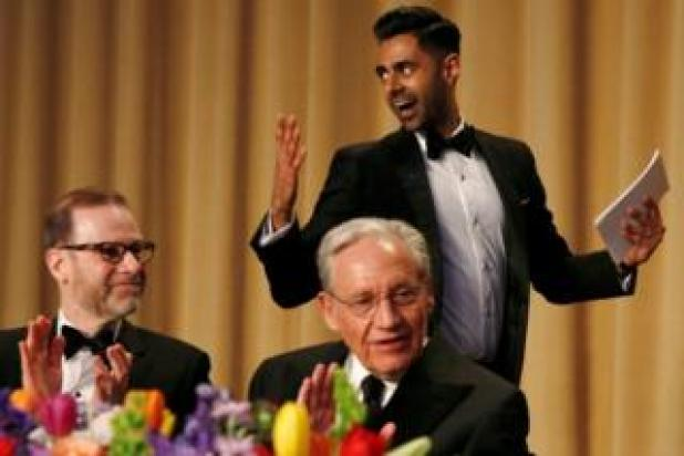 Comedian Hasan Minhaj (R) had a tough crowd in Washington Post journalist Bob Woodward (C) and Reuters Editor-in-Chief Steve Adler (L)