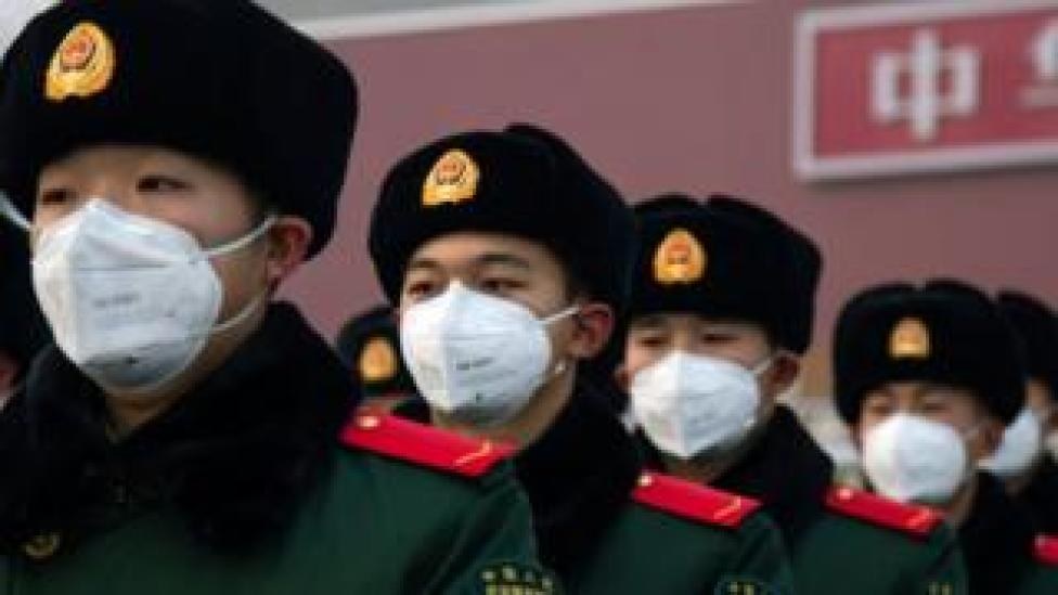 trump Chinese policemen wearing face masks