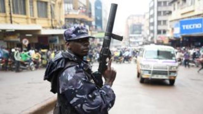 A police officer with a weapon to shoot tear gas canisters in Kampala, Uganda - Wednesday 11 July 2018