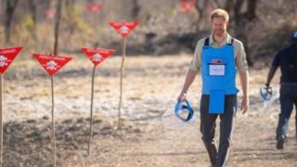 Prince Harry walking through a minefield in Angola