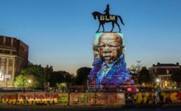 John Lewis projected on to Robert E Lee statue