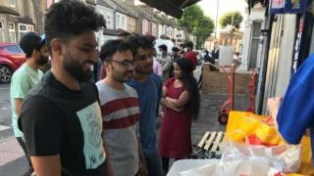 Greenwich university MBA students queue for food