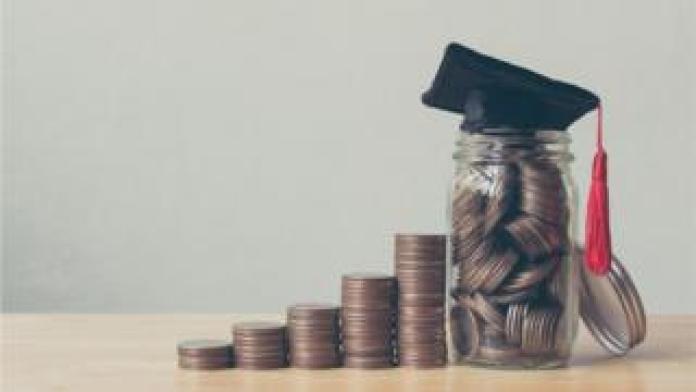 Coins, a pot and a mortar