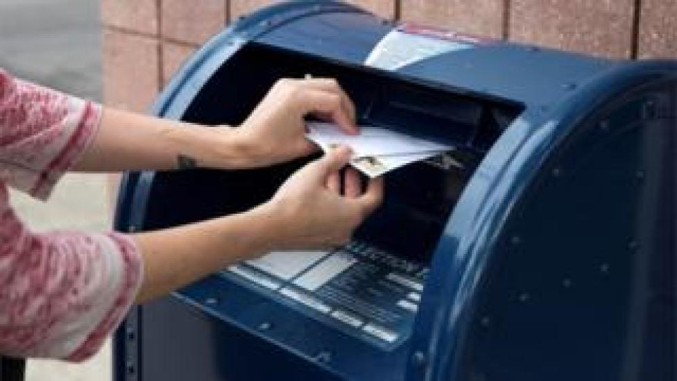 A woman posts a letter