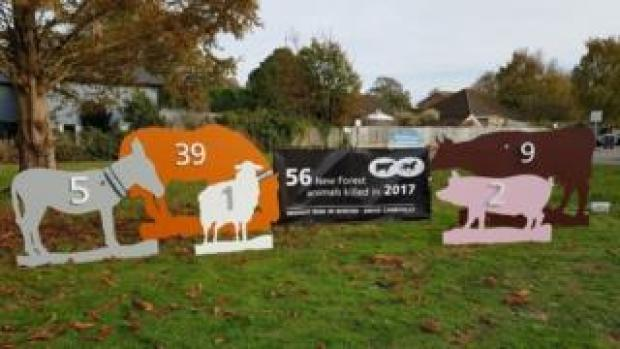 The animal silhouette signs being placed around the New Forest