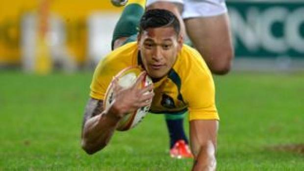 Israel Folau scores a try while playing for the Wallabies during a test match in 2017