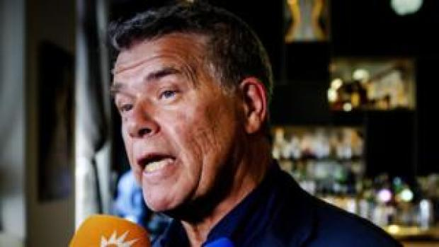 Emile Ratelband, 69, speaks with the press in a bar in Amsterdam