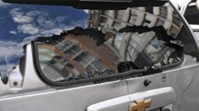 View of the damaged rear window of a vehicle after supporters of Venezuelan President Nicolas Maduro attacked a convoy of opposition lawmakers