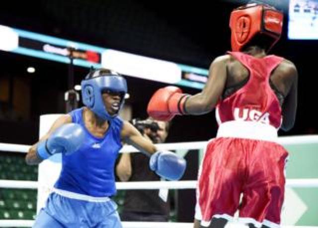 Kenyan boxer Christine Ongare (L) fighting Uganda's Catherine Nanziri (R) in Dakar, Senegal - Saturday 29 February 2020