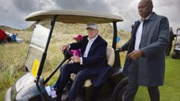 President Trump driving a golf buggy
