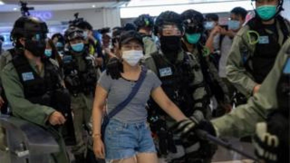 Police detain a woman, (C), during a protest in a shopping mall in Hong Kong, China, 06 July 2020. Several dozen protesters held up sheets of blank paper after the government issued a statement linking the 'Liberate Hong Kong, revolution of our times' slogan, used during mall protests, to separatism.