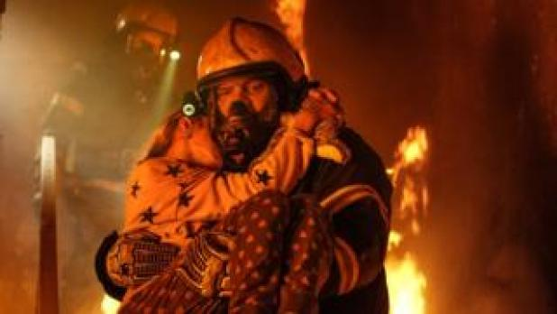 Fireman carrying child