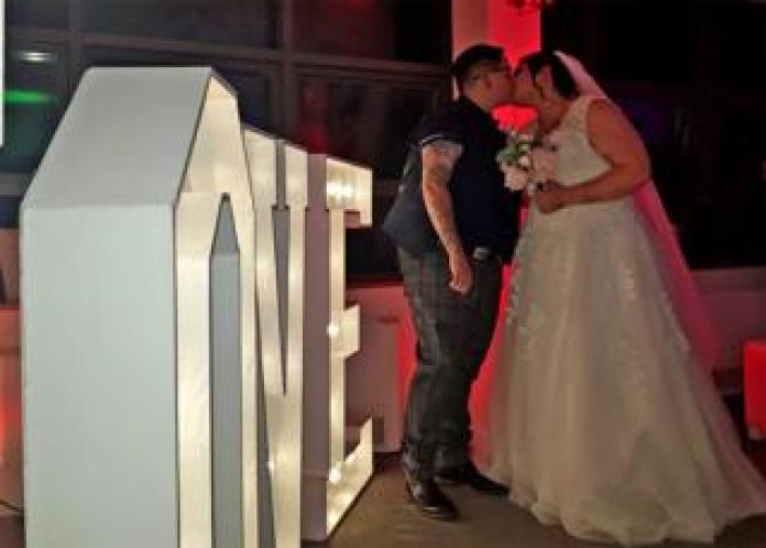A wedding couple kissing