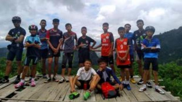 Group of teenage boys with coach
