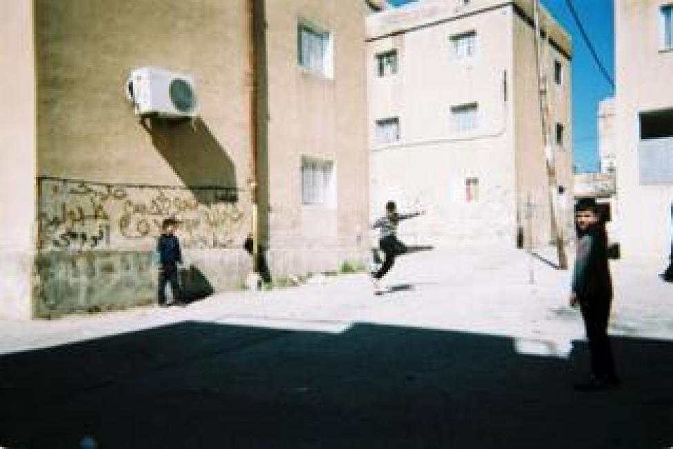 sport Children play football outdoors