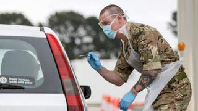 A soldier helps conducting COVID-19 testing for NHS key workers at a testing site in Plymouth