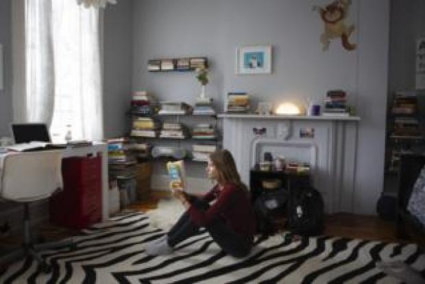 Maddie reads in her room