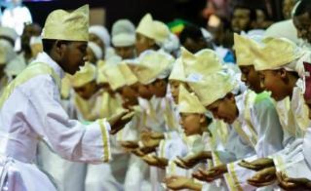 Tens of thousands of Ethiopian Orthodox believers gather at Millennium Hall in Addis Ababa, on August 4, 2018