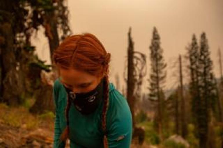 Hiker wears a buff over her head