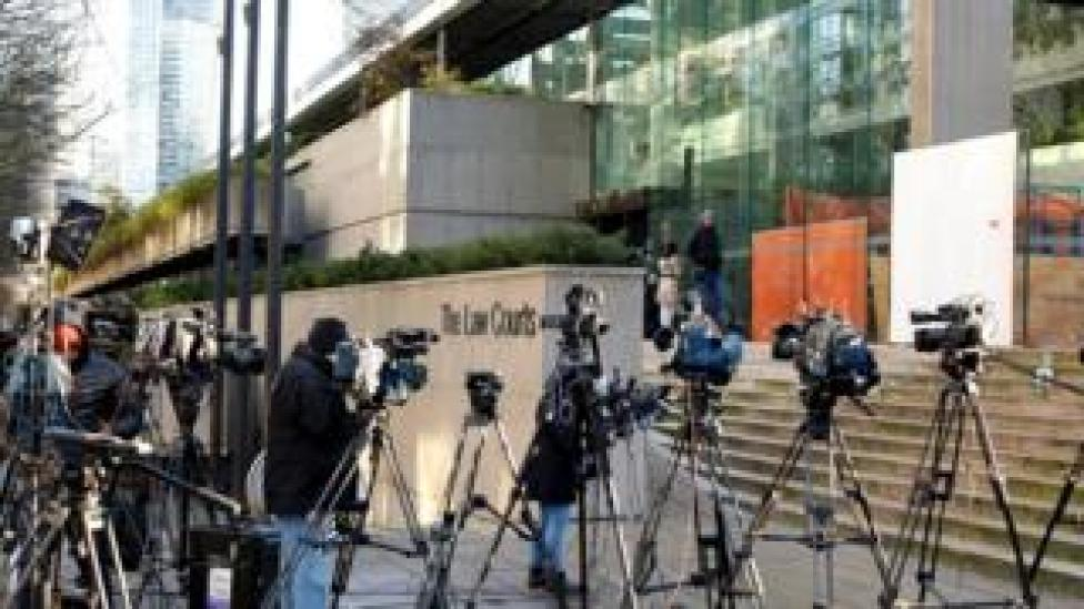Members of the news media stand outside the BC Supreme Court bail hearing of Huawei CFO Meng Wanzhou, who was held on an extradition warrant in Vancouver, British Columbia, Canada December 7, 2018