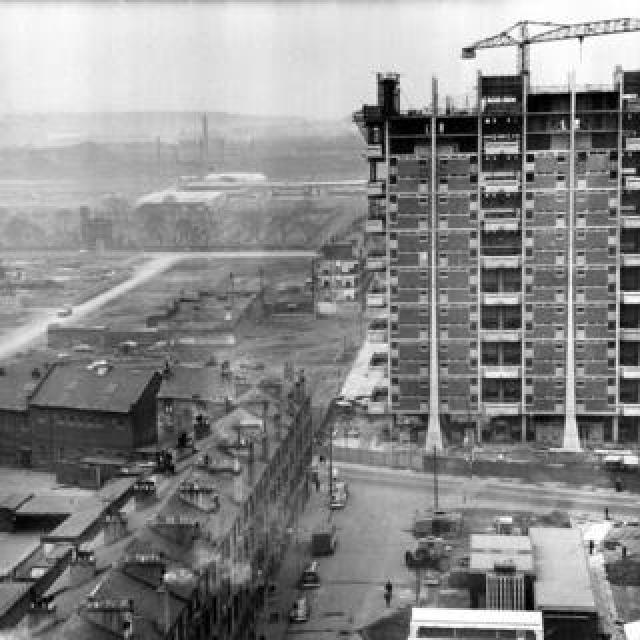 Modern housing under construction beside old tenements in the Gorbals area of Glasgow