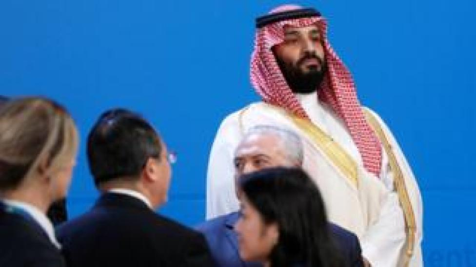 Saudi Crown Prince Mohammed bin Salman looks out as leaders arrive for a family photo at the G20 in Buenos Aires