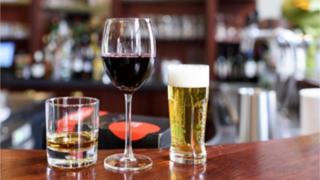 Whisky, wine and beer on a bar