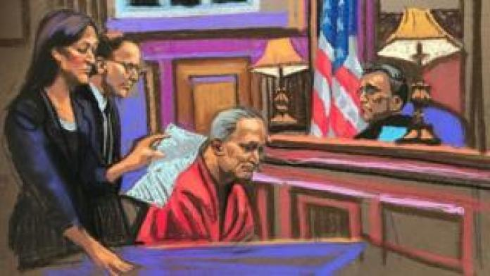 A drawing of Robert Bowers in court looking down while a lawyer addresses the judge