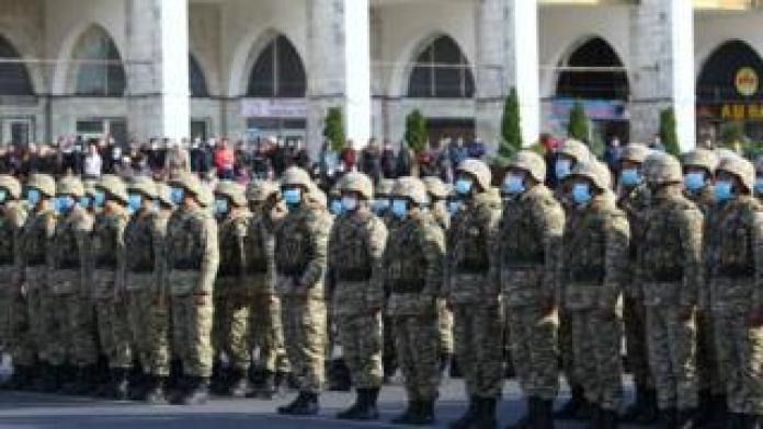 Members of Kyrgyz armed forces stand in formation in Ala-Too Square