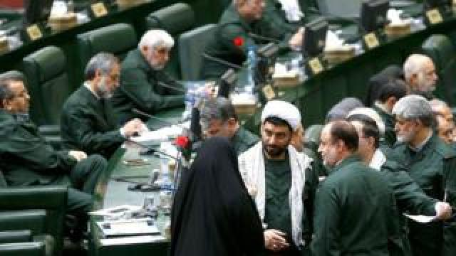 Iranian lawmakers wearing Iranian Revolutionary Guard Corps uniforms at the Iranian parliament in Tehran, 09 April 2019