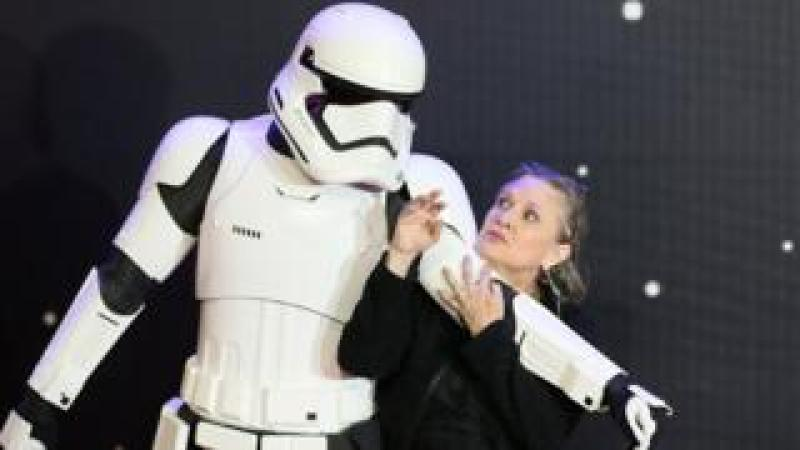 """Carrie Fisher poses for cameras as she arrives at the European Premiere of """"Star Wars, The Force Awakens"""" in Leicester Square, London, Britain December 16, 2015"""