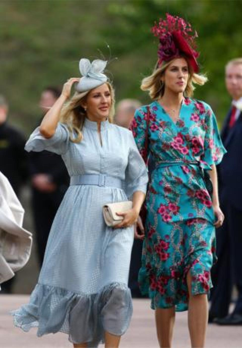 NEWS Ellie Goulding and a guest arrive at the royal wedding