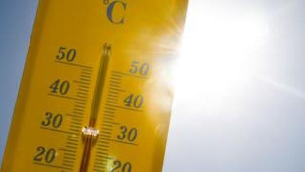 A thermometer is seen in the sun during the heatwave in Rennes, France