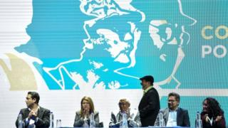 "FARC leader Rodrigo Londono Echeverri, generally ""Timochenko""(C) gets prepared to speak during the opening of their nationwide Congress in Bogota on August 27, 2017."