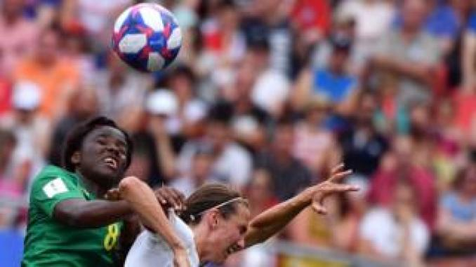 Cameroon's midfielder Raissa Feudjio (L) vies with England's midfielder Jill Scott during the France 2019 Women's World Cup round of sixteen football match between England and Cameroon, on June 23, 2019, at the Hainaut stadium in Valenciennes, northern France.