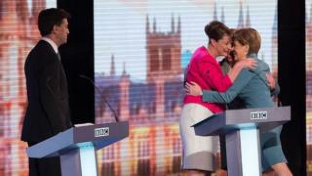 Ed Miliband watches as Leanne Wood, Natalie Bennett and Nicola Sturgeon share a hug after a 2015 BBC election debate