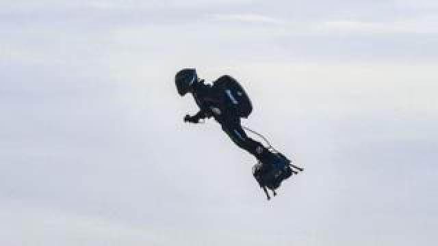 """Franky Zapata stands on his jet-powered """"flyboard"""" after he took off from Sangatte, northern France"""