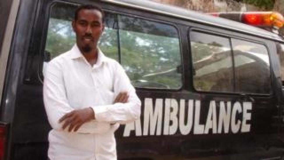 Abdulkadir Abdirahman Adan standing against an ambulance