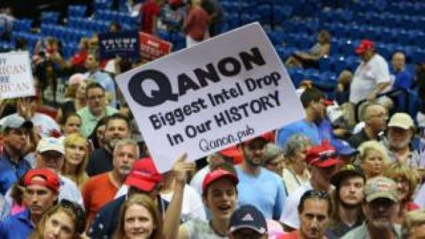 Trump supporters displaying QAnon posters appeared at President Donald J. Trumps Make America Great Again rally Tuesday, July 31, 2018