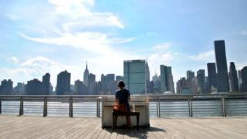 A woman plays a piano in New York in 2010 for the Play Me, I'm Yours project