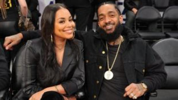 Nipsey Hussle and Lauren London at an NBA game
