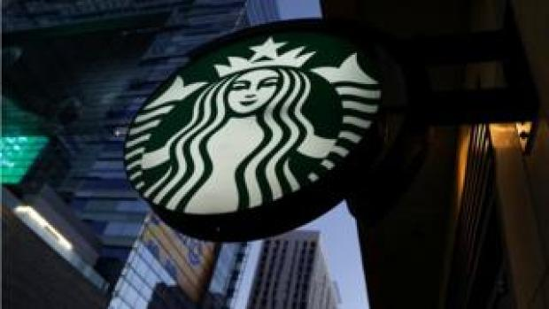Starbucks sign hanging in Los Angeles, California