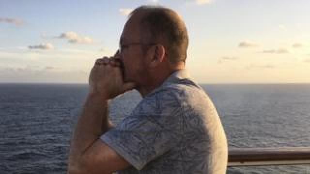 Neil Garnham looking out to sea