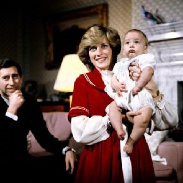 The Prince and Princess of Wales at Kensington Palace with baby son Prince William. 22 December 1982