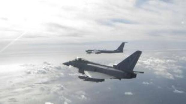 a Eurofighter Typhoon (near) and a Russian Bear F aircraft (far), one of two Russian aircraft the Typhoon has been sent to intercept off the Scottish Coast from Leuchars Station